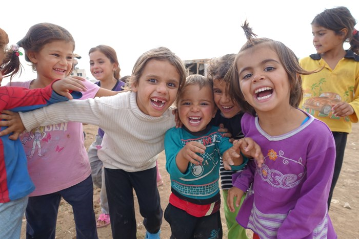 Syrian refugee children find reasons to smile despite the difficulties of their lives in Lebanon. (Photo: John Bowen)