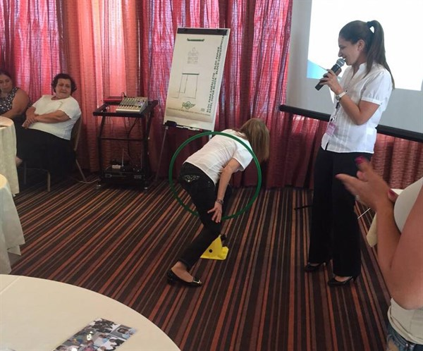 """An occupational therapist demonstrating to teachers how our ability to """"locate our bodies in space"""" impacts our ability to read and write."""