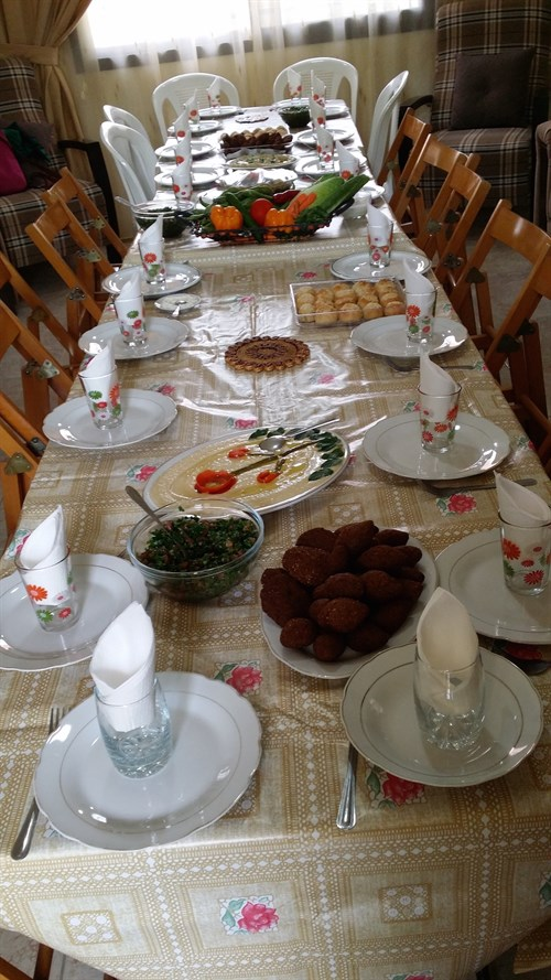 The team shared a meal with a Lebanese family after church in South Lebanon. (Photo: Joy Zeigler)